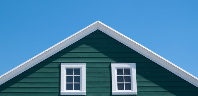 Green house and white roof with blue sky in sunny day